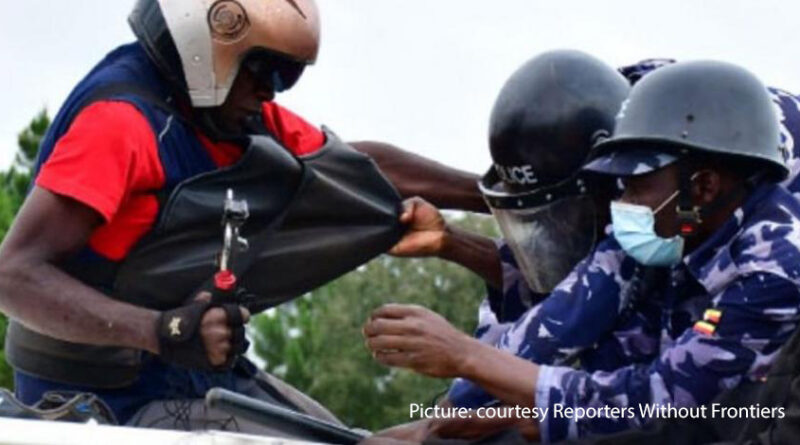 A radio reporter is challenged by police in Uganda during demonstrations in December in the Presidential election campaign.
